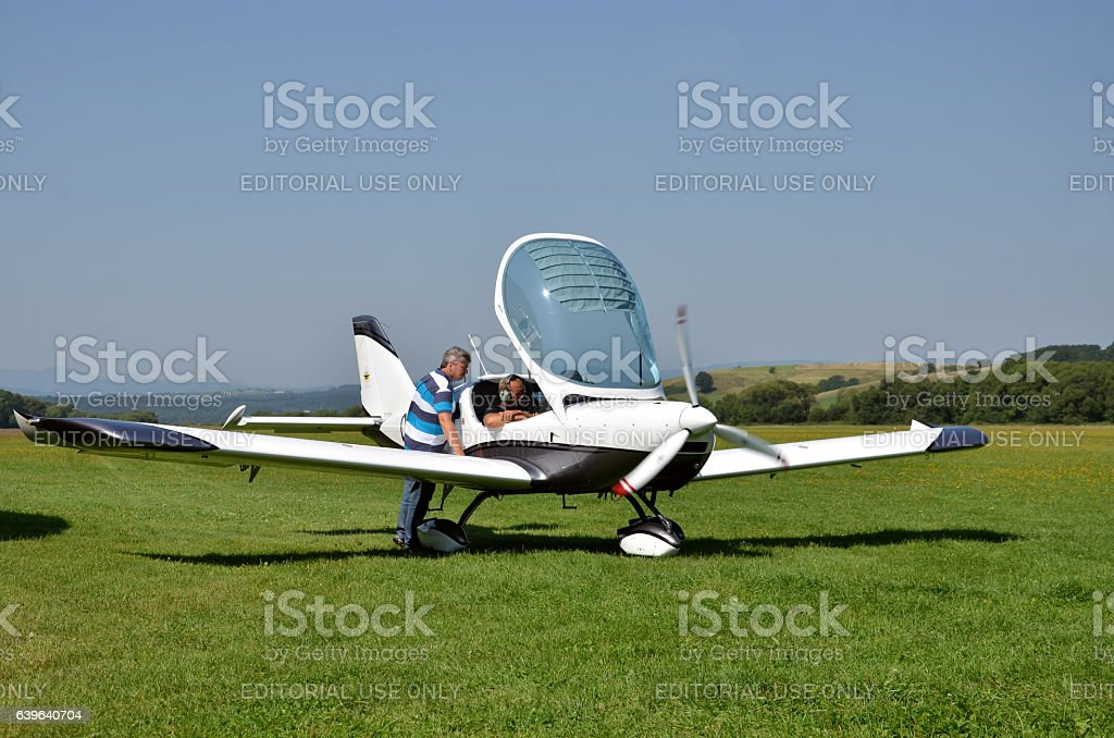 Men check airplane before taking off and prepare for flight stock photo