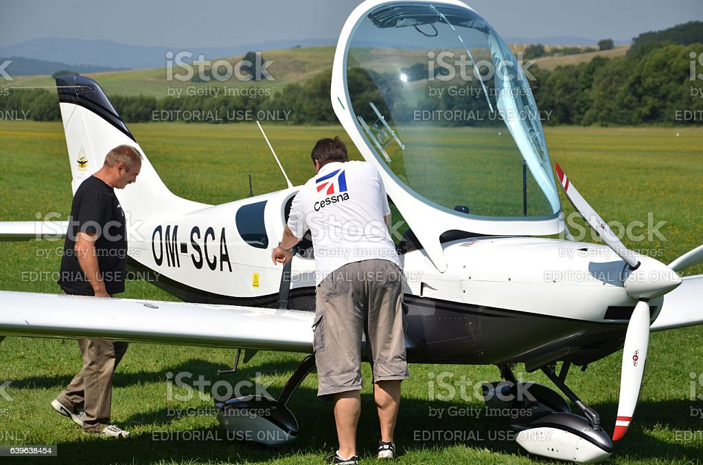 Men check airplane before taking off, prepare for the flight stock photo