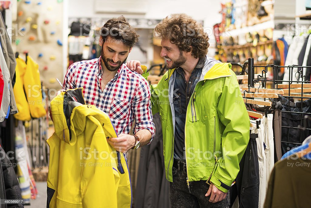 Men choosing wardrobe stock photo