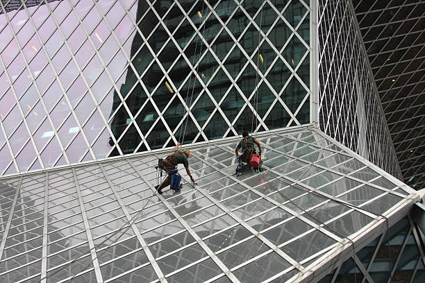 Men Cleaning A Glass Building stock photo