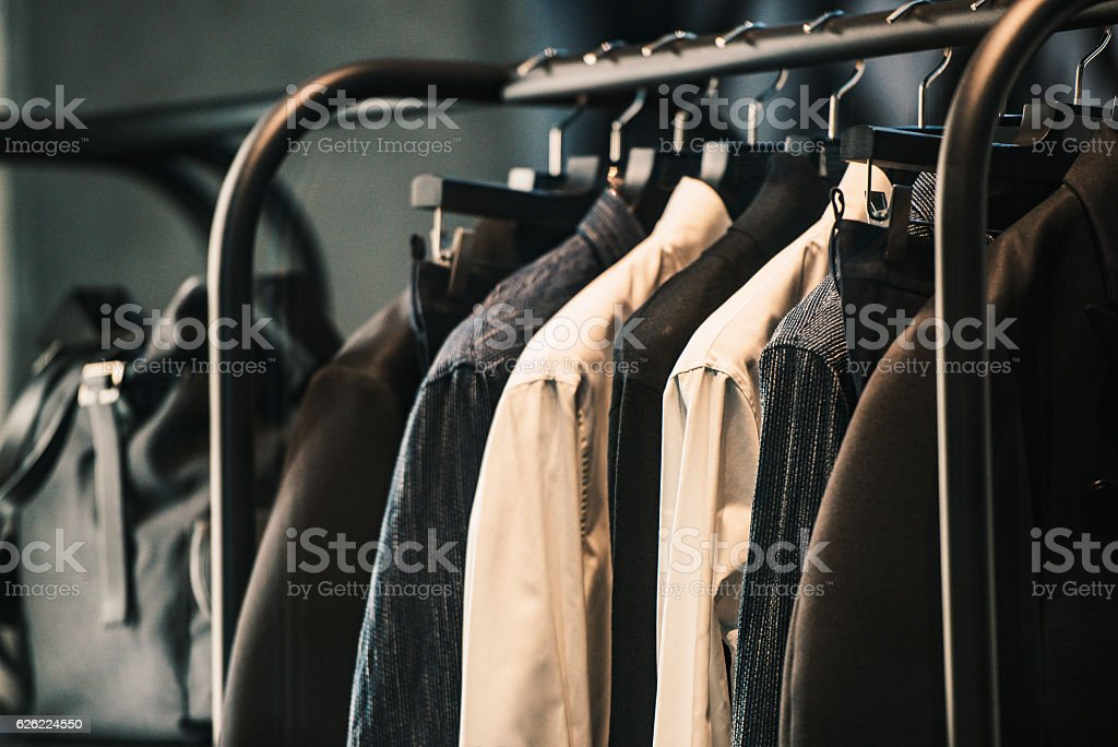 Men clothing on a rack - closeup photo stock photo