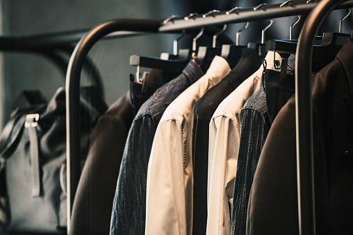 Men clothing on a rack - closeup photo stock photo