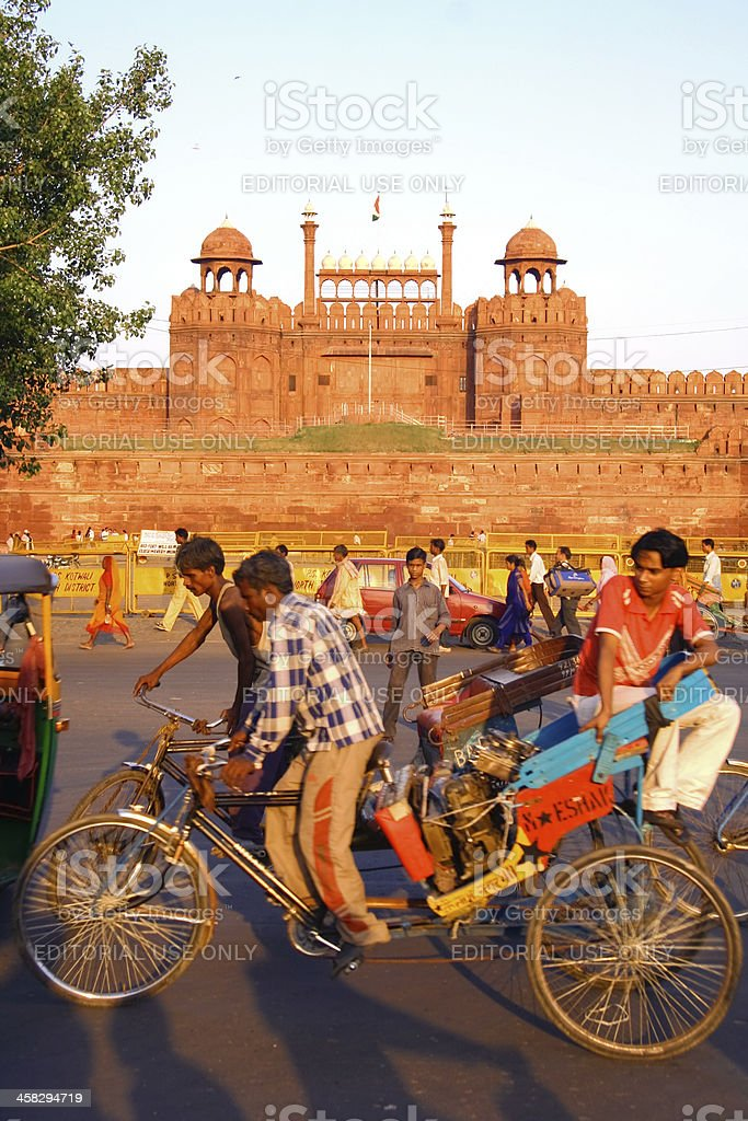Men cycling by fort stock photo