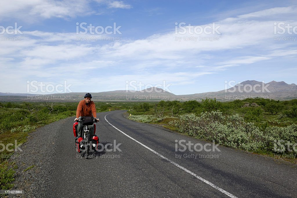 men cycling in Iceland stock photo