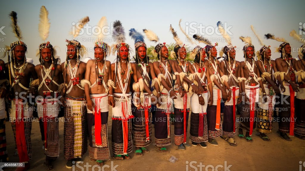 Men dancing Yaake dance and sing at Guerewol festival in InGall village, Agadez, Niger stock photo