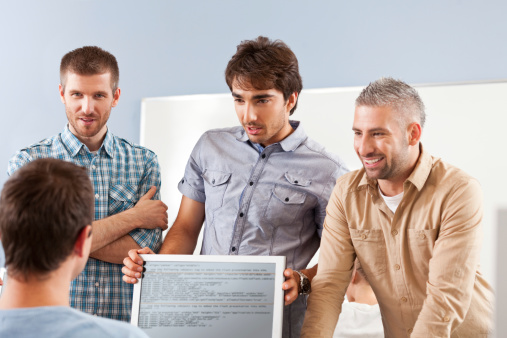Men Discussing Project Stock Photo - Download Image Now