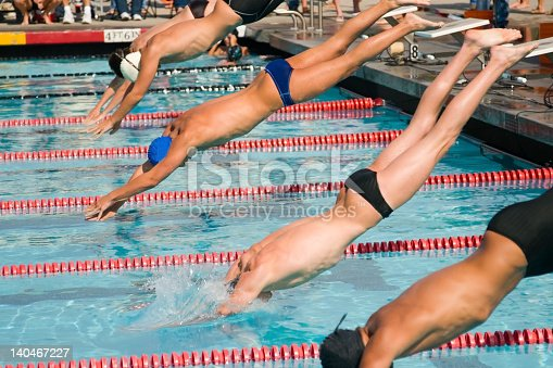 177281231 istock photo Men diving into the pool for swimming finals 140467227