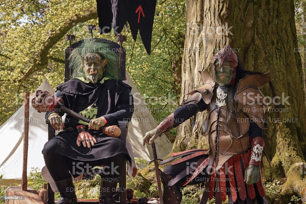 Men dress up as malevolent trolls during the Elfia event stock photo