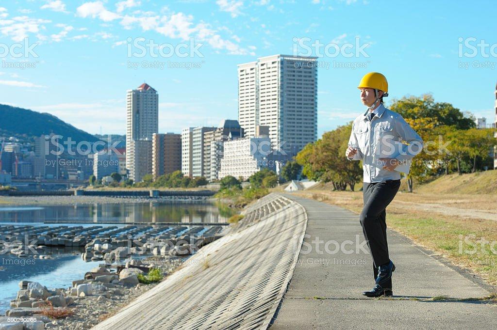 Men dressed in work clothes standing outdoors royaltyfri bildbanksbilder