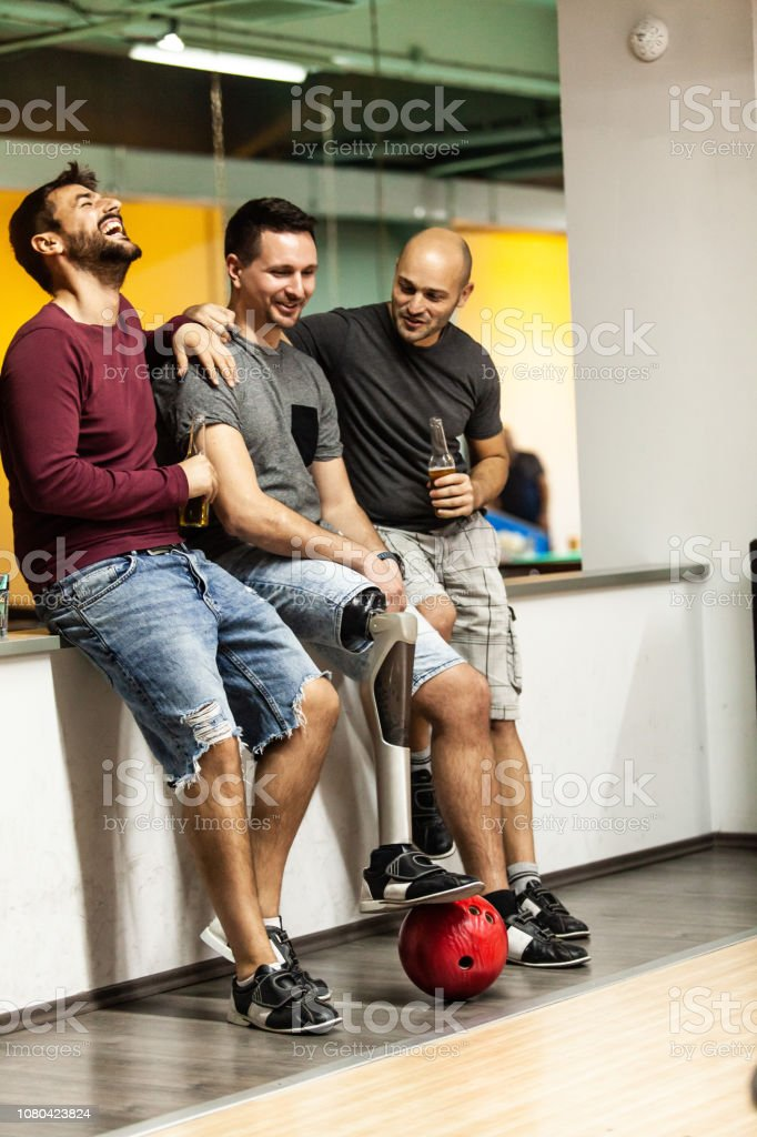 Men drinking beer after bowling stock photo