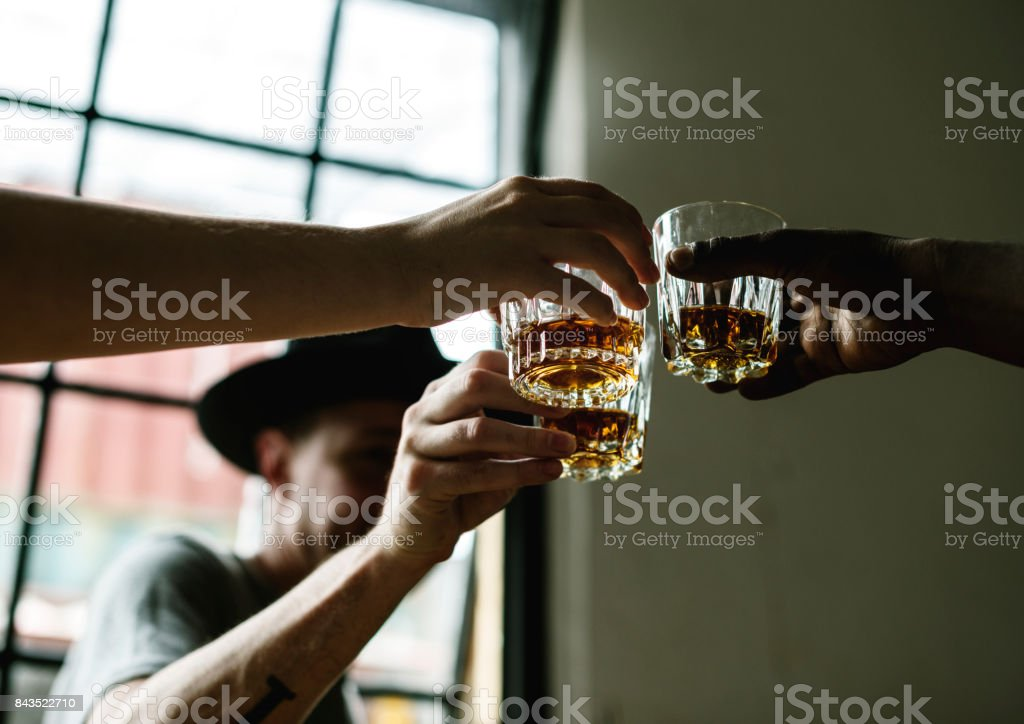Men drinking whiskey together stock photo