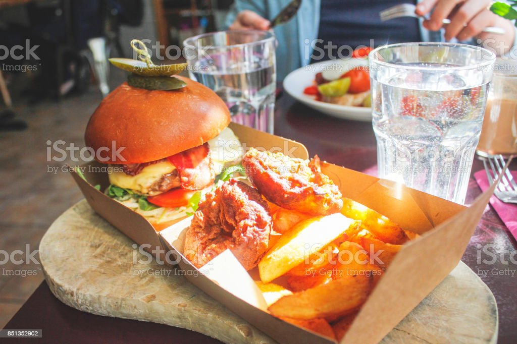 Men eating a big lunch meal stock photo