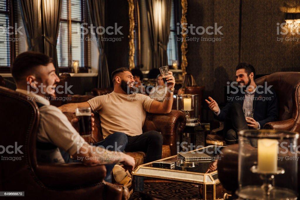 Men Enjoying Drinks stock photo