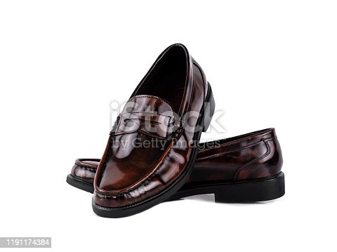 Men fashion leather brown loafer shoe isolated on a white background.