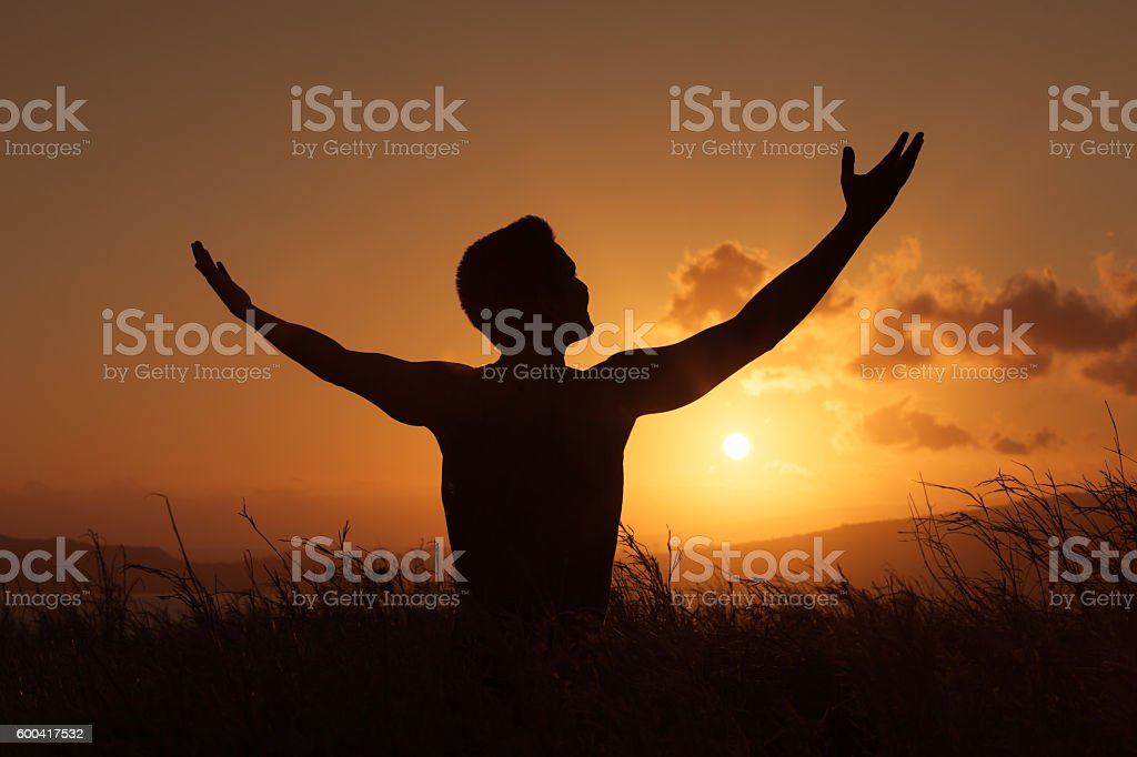 Men feeling free in natural setting stock photo