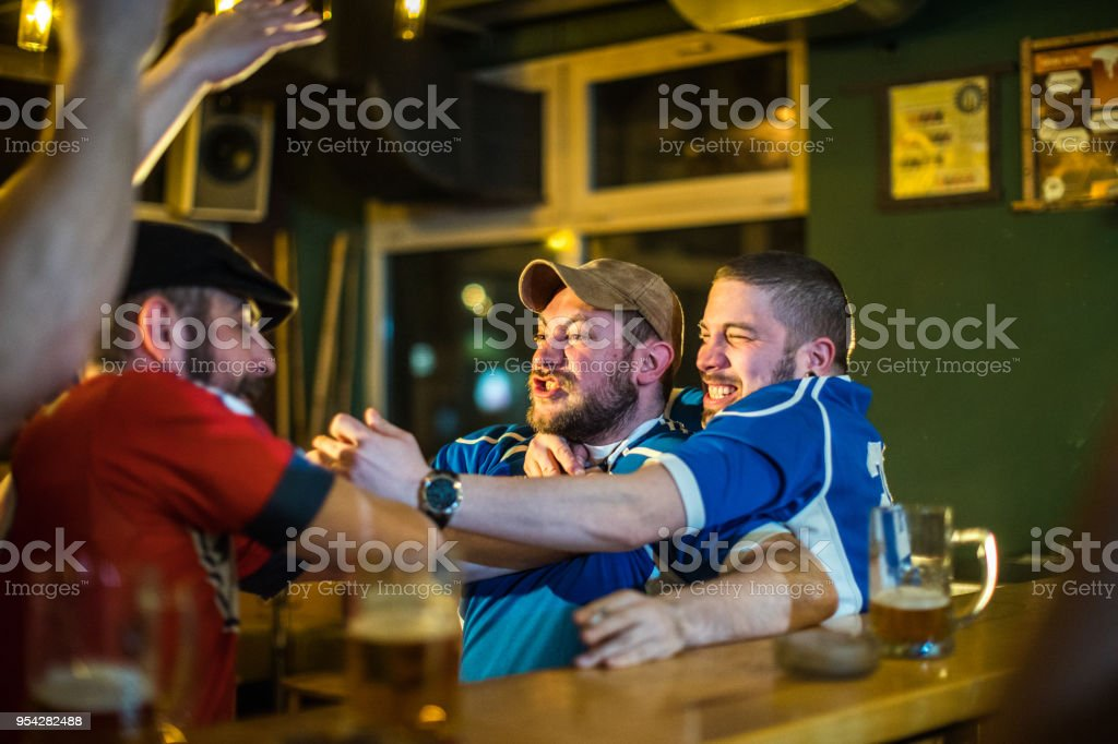 Men fighting in a pub stock photo