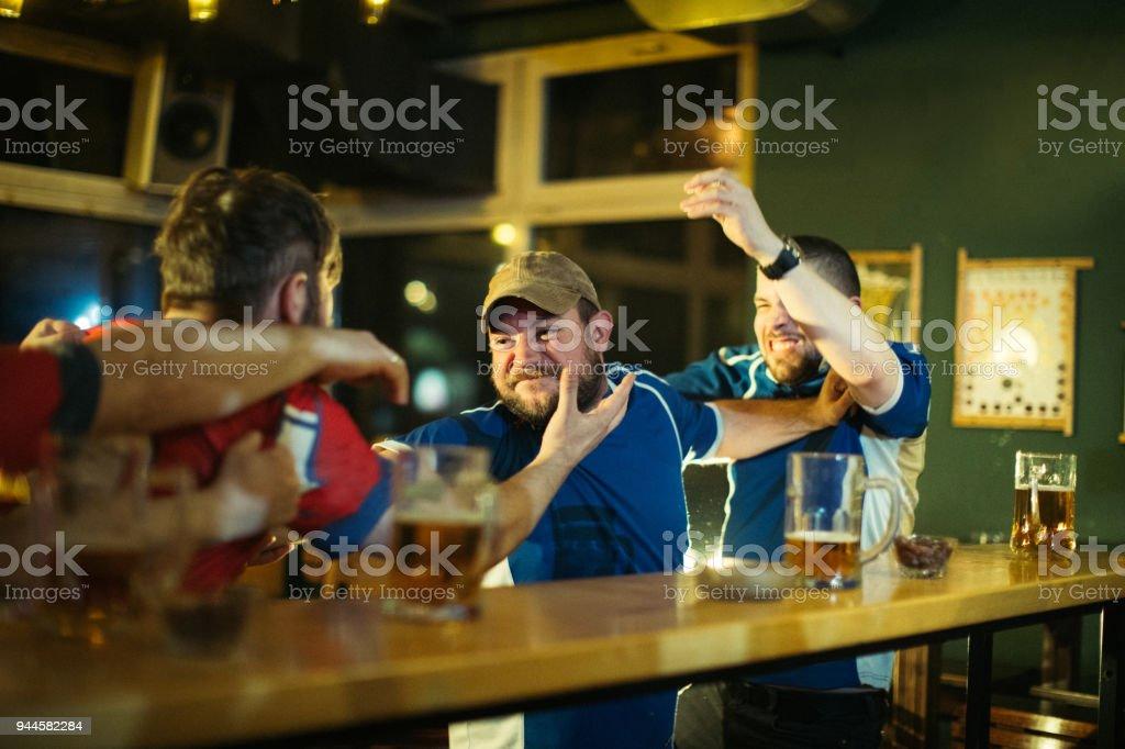 Men fighting in pub stock photo