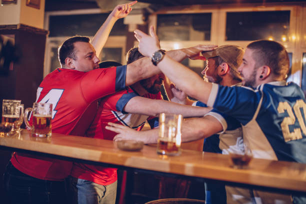 Men fighting in sports pub stock photo