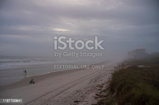 1054156720istockphoto Men fish with fishing rods off the Atlantic coast during a morning sunrise at Wilber-By-The-Sea, Florida. 1197700641