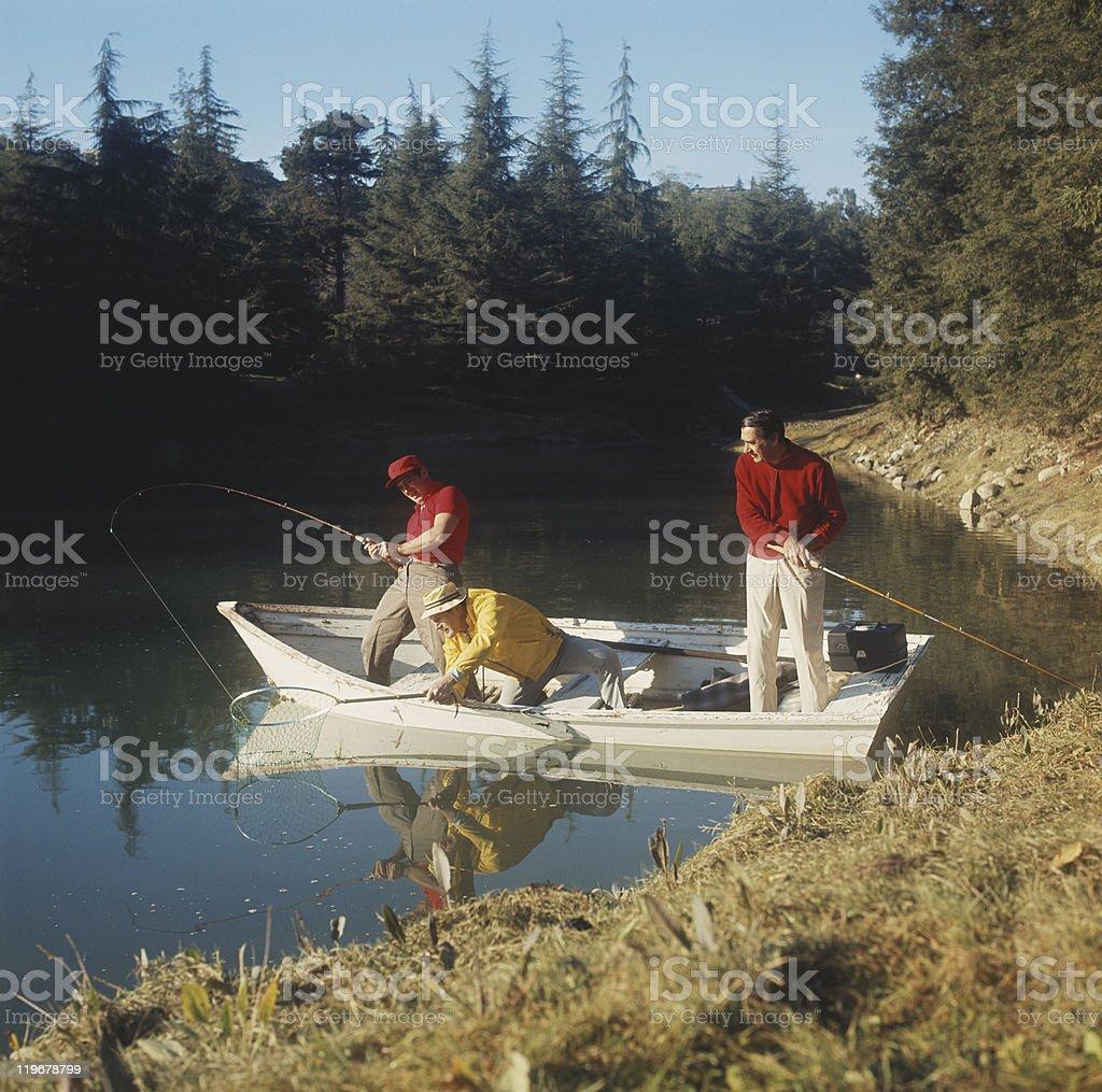 Men fishing in lake stock photo