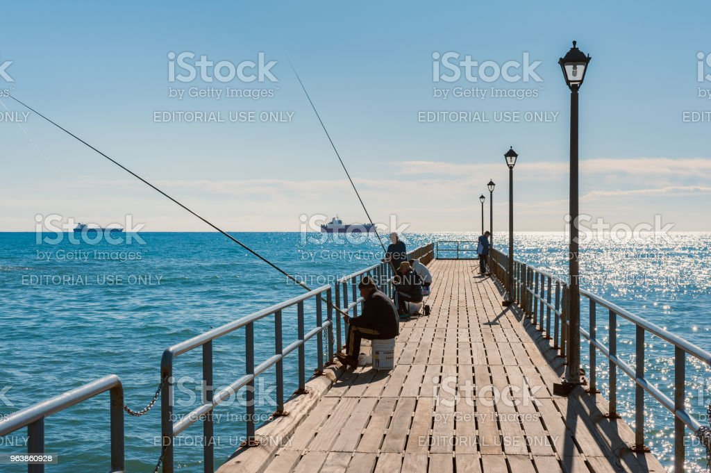 Men Fishing on Jetty in Limassol Cyprus - Royalty-free Adult Stock Photo