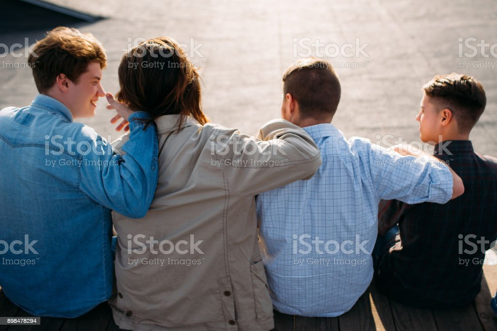 men friendship teenager hug bff support unity stock photo