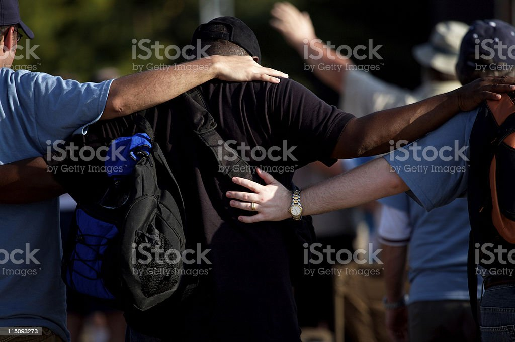 men gathering prayer embrace royalty-free stock photo