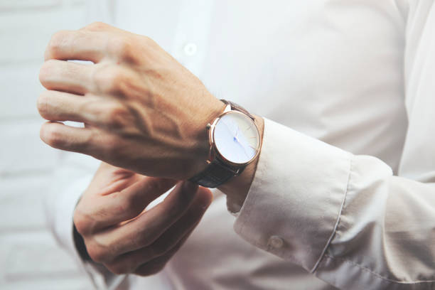 men  hand with a watch stock photo
