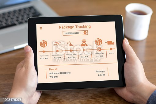 istock men hands holding tablet with app package tracking on screen 1003475078