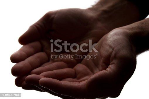 istock Men hands together, handful - silhouette 1154067509