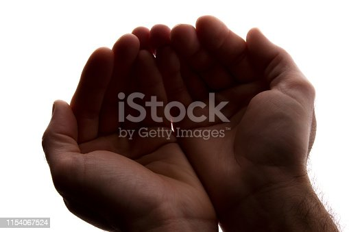 883034410 istock photo Men hands together, handful - silhouette 1154067524