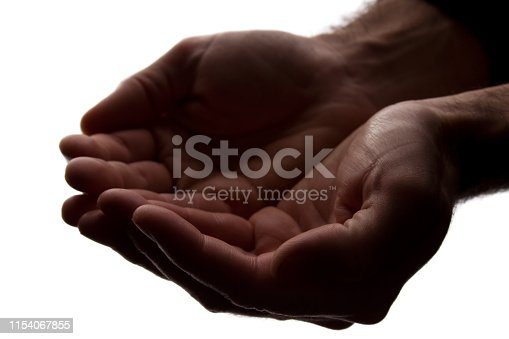 883034410 istock photo Men hands together, handful - silhouette 1154067855