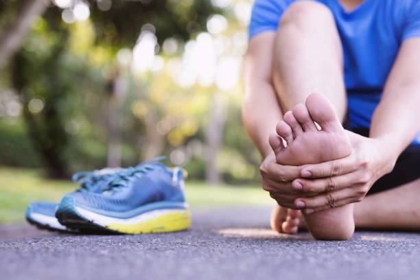 Men have a lot of leg pain in the park due to strenuous exercise. Men have a lot of leg pain in the park due to strenuous exercise. sports medicine stock pictures, royalty-free photos & images