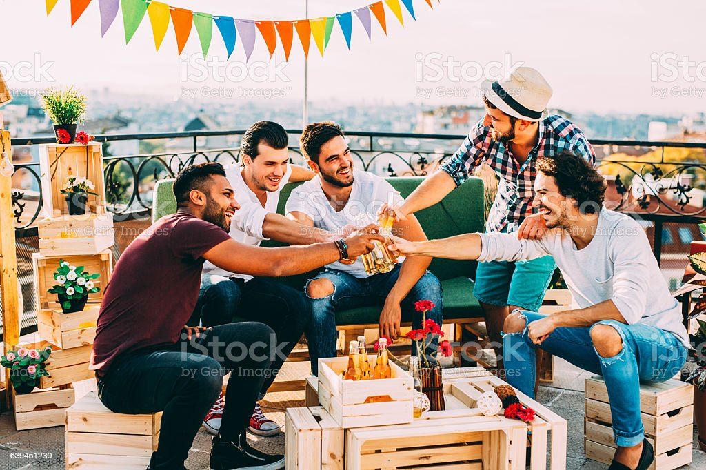 Men having a toast at a party stock photo
