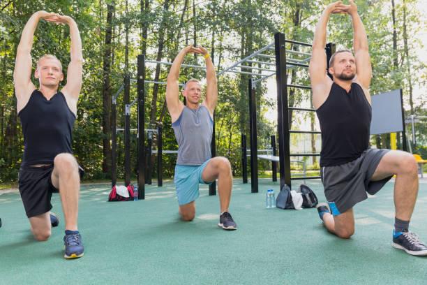 Men having calisthenics workout stock photo