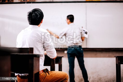 491577806 istock photo Men having presentation in spacious hallway 1149077626