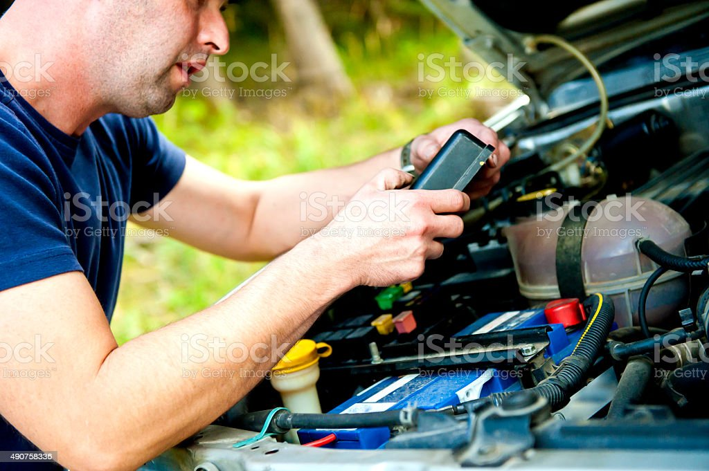 Men having problem with car stock photo