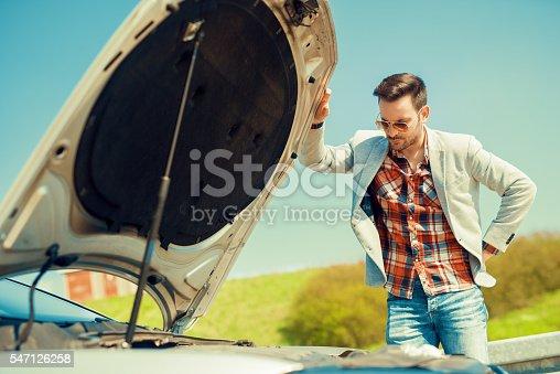 istock Men having problem with car. 547126258