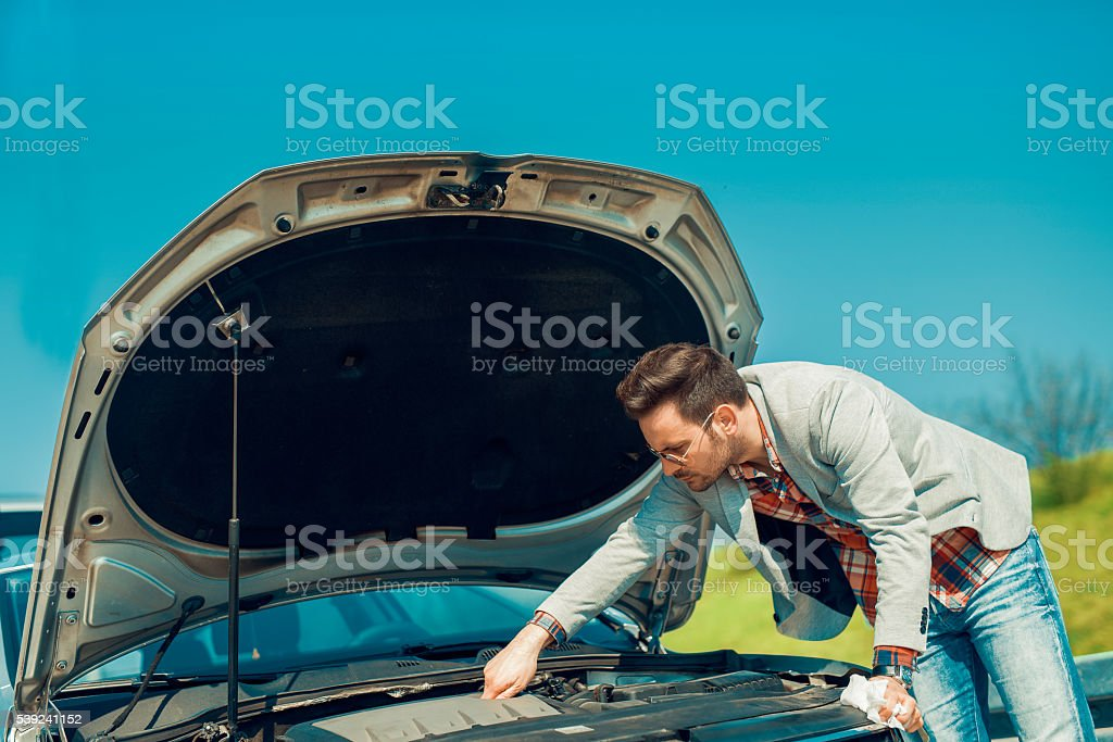 Men having problem with his car royalty-free stock photo