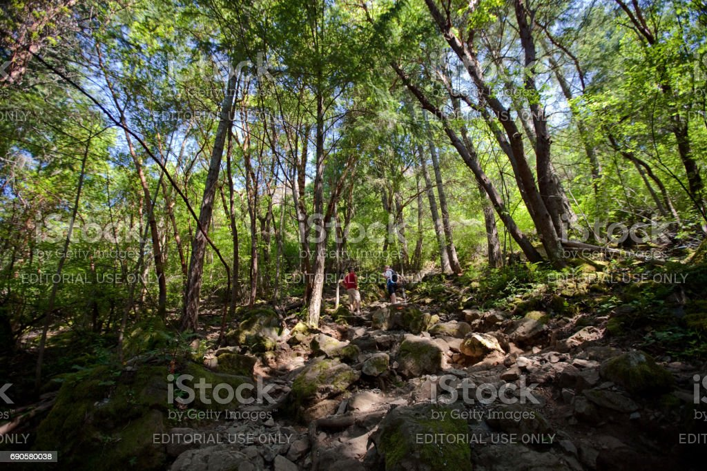 Men Hiking Mount Finlayson stock photo