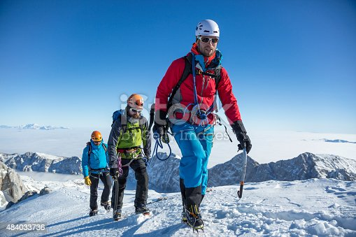 istock Men hiking on snow covered landscape 484033736