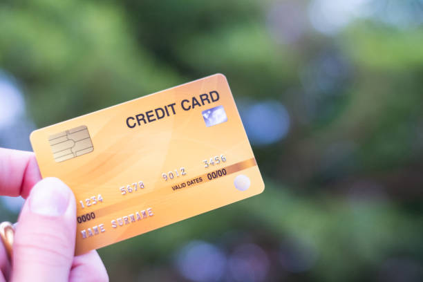 Men  hold credit card with bokeh background stock photo