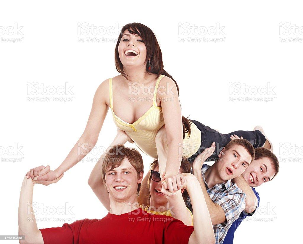 Men hold girl on hands. stock photo