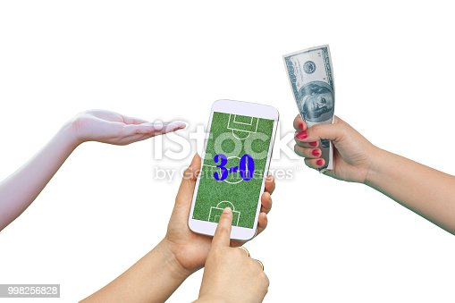 istock Men hold Mobile to play Football Betting online . 998256828