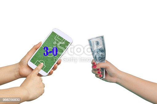 istock Men hold Mobile to play Football Betting online . 998256830