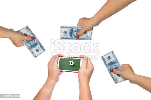 istock Men hold Mobile to play Football Betting online . 998256834