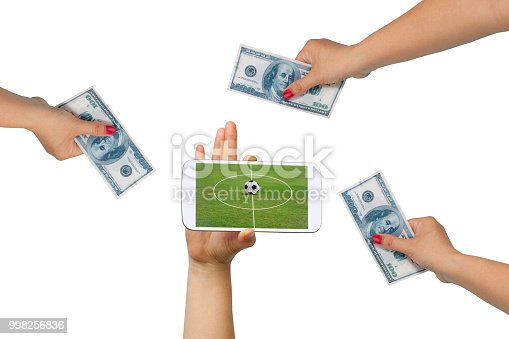 istock Men hold Mobile to play Football Betting online . 998256836