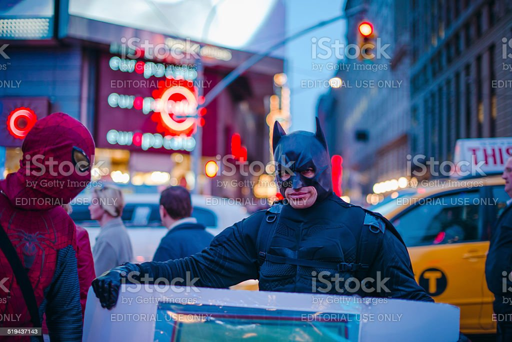 Men in Batman and Spiderman costumes stock photo