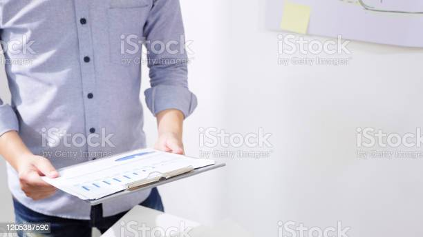 Men in casual wear are holding company earnings data files report the picture id1205387590?b=1&k=6&m=1205387590&s=612x612&h=ulr3aqzp9sheumd 4fspjuw4mkmbl bua2xs80mrvty=