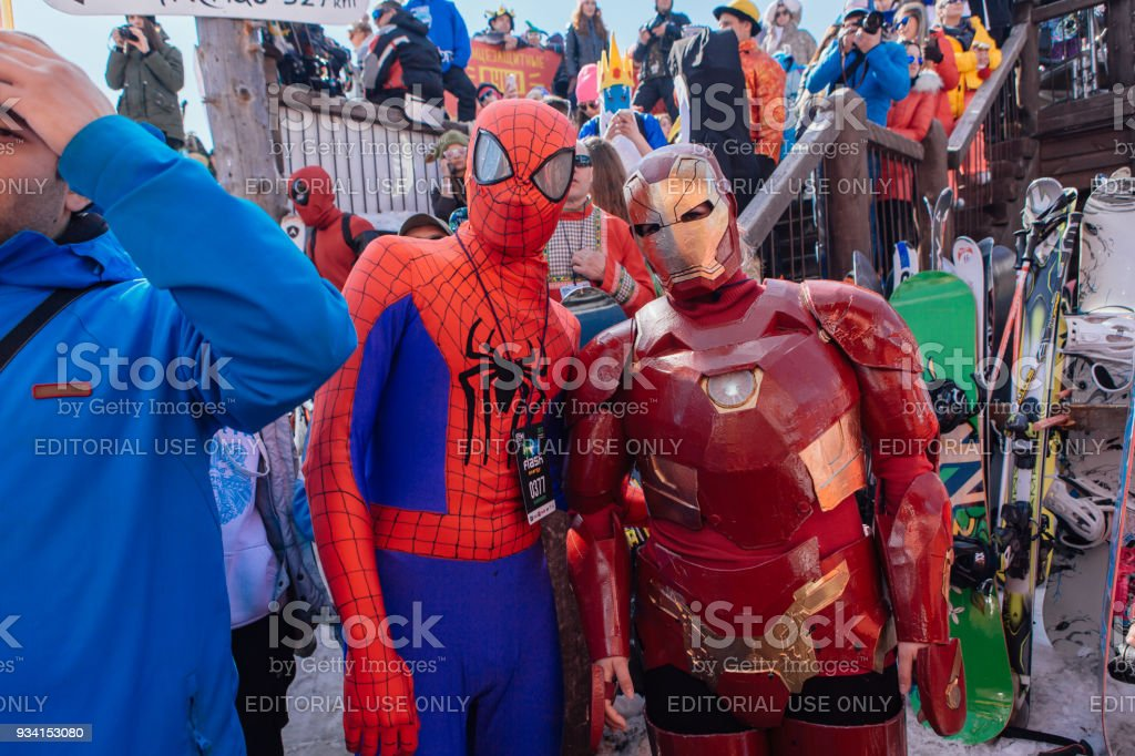 Men in costumes of spiderman and ironman. stock photo
